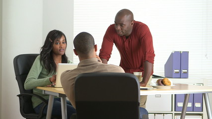 Black business colleagues working in office