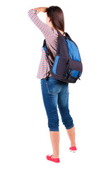 back view of standing young beautiful  brunette woman with backp