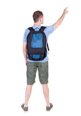 Back view of  pointing man with backpack looking up