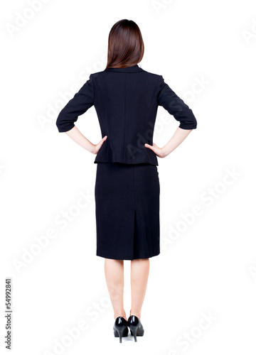 back view of thoughtful business woman contemplating.