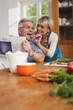 Deutschland, Kratzeburg, ältere Frau, Seniorin lässt Gurke probieren