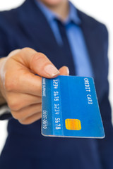 Closeup on credit card in hand of business woman