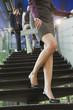 Deutschland, Frau steht auf einer Treppe, Verbotsschild im Vordergrund
