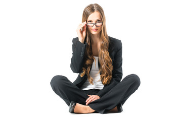 Young business woman with glasses scrutinizing