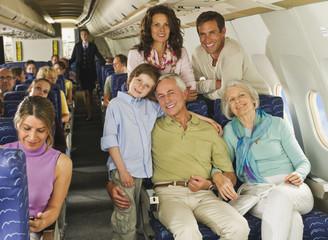 Deutschland, München, Bayern, Gruppe von Passagieren in der Economy-Klasse Verkehrsflugzeug