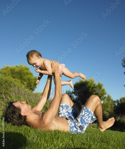 Dad and child playing in the garden
