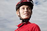 Deutschland, Bayern, junge Frau mit Fahrradhelm, close up