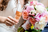 Fototapety Beautiful bridal bouquet  and glass of champagne close-up
