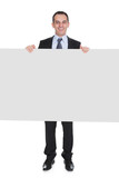 Businessman Holding Placard