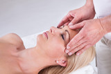 Woman Having Facial Massage In Spa Centre