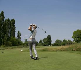 Male golfer swings