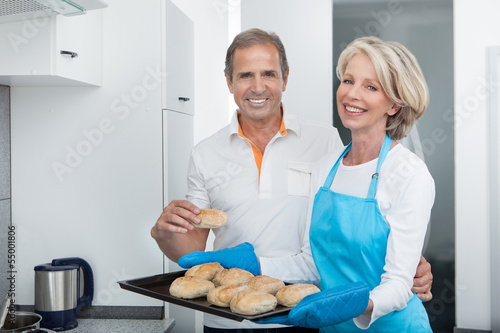 Woman Taking Baking Tray Out From Oven