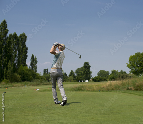 Male golfer swings
