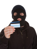 Contemplating Burglar Holding Credit Card