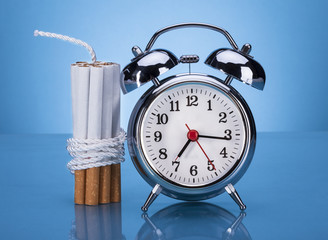 Cigarettes Tied With Rope And Alarm Clock