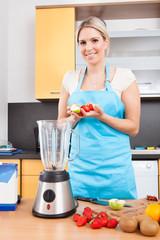 Woman Making Strawberry Milkshake