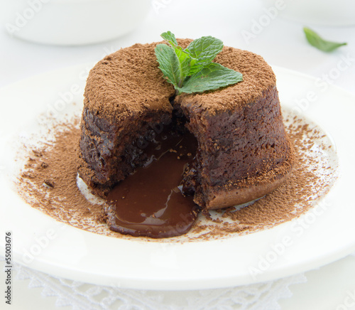 Chocolate dessert fondant with a liquid center and strawberries.