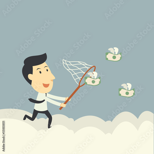 businessman trying to catch money fly