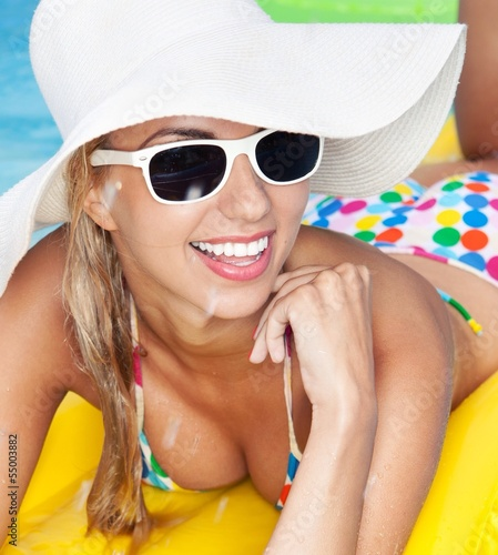cheerful woman relaxing in a pool