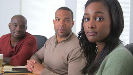 Smiling black business partners at desk