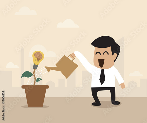Businessman watering a light bulb idea plant