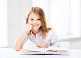 little student girl studying at school - Fine Art prints