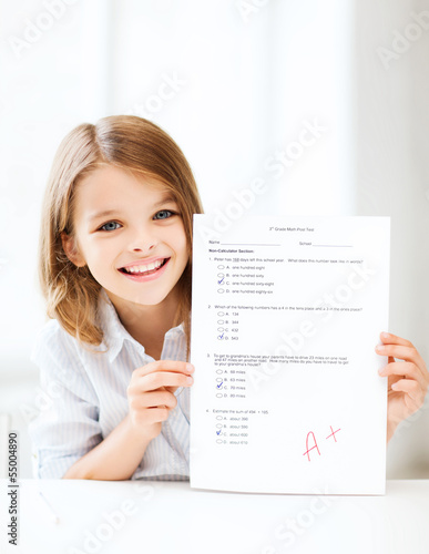 girl with test and grade at school
