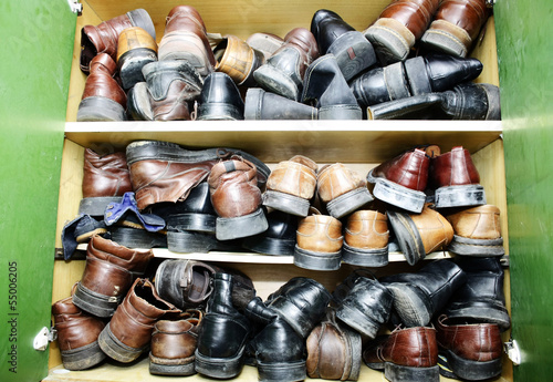 Cabinet full of leather shoes