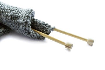 Wool knitting on wooden needles