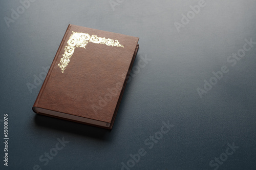 Closed book on desk