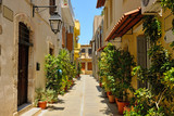 Typical narrow street in city of Rethymno, Crete, Greece - 55009657