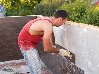 Stonemason working on a house