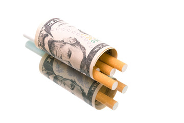 money and cigarettes on a white background with reflection