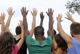 Diverse group raising hands