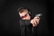 boy shoots from a gun