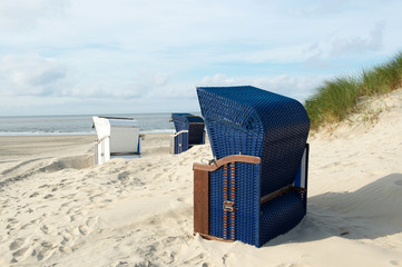 Borkum beach with blue and white chairs