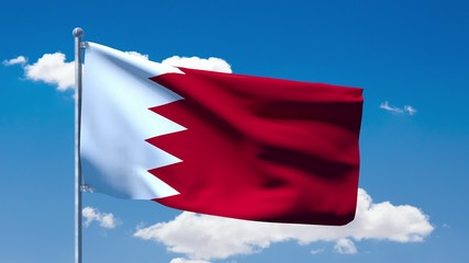 Bahraini flag waving over a blue cloudy sky