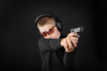 boy shoots from a gun