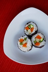 Vegetarian sushi maki rolls with tofu and nori seaweed