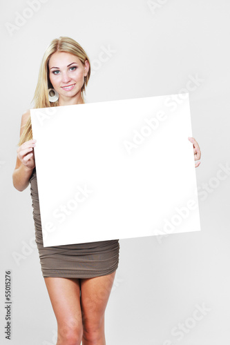 girl hold white blank paper card
