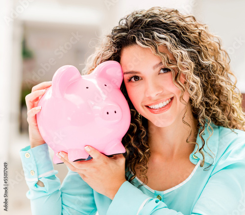 Happy woman with a piggybank