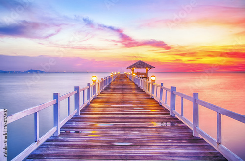 canvas print picture Wooded bridge in the port between sunrise