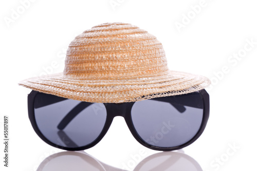 sunglasses and hat for protection in summer