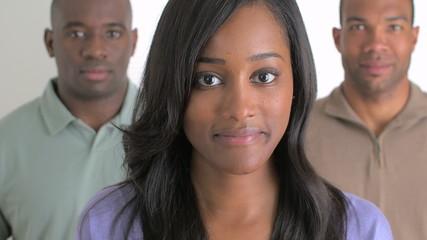 Confident black businesswoman and her team