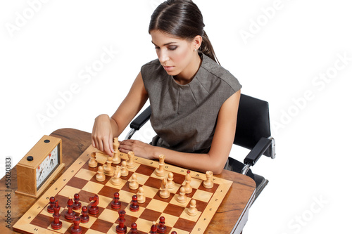 Sexy clever brunette woman playing chess