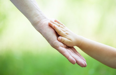 Child's and gather's hands