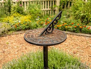Garden sundial with blurred background