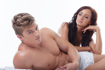 Image of beautiful sexy people posing in bed