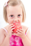 Portrait of happy child eating red apple