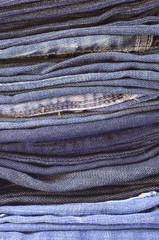 close up stack of folded jeans vertical